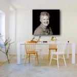 Schilderij van foto boven een eettafel